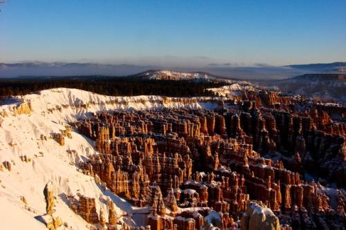 The first glimpses of the morning sun illuminate rock formations at Inspiration Point in Bryce Canyon National Park, Utah, on Thursday, Dec. 24.