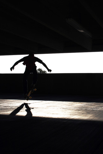 Wesley Oliver, a sophomore at the UA, passes time skateboarding in the Sixth Street parking garage. Skateboarding enthusiasts often hit up the garages on their spare time.