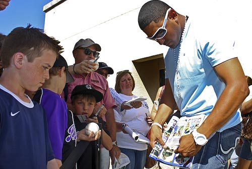 Colorado Rockies fans line up for autographs from their favorite players at the last spring training game in Tucson.