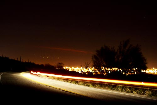 Light streams across a midnight road through the west side of Interstate 10.