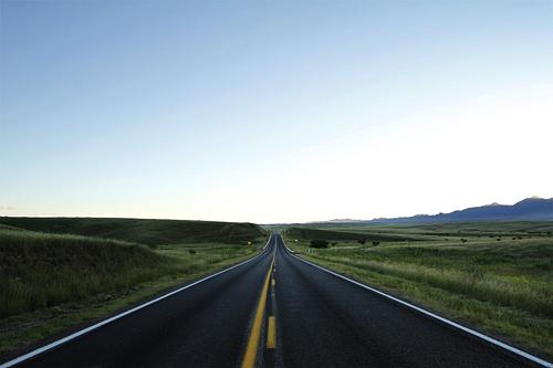 Highway 82 cuts through seemingly endless grassy hills near Sonoita, AZ.