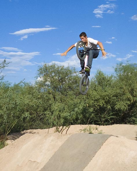 A rider performs a trick at Barrio Trails, which will be demolished soon.